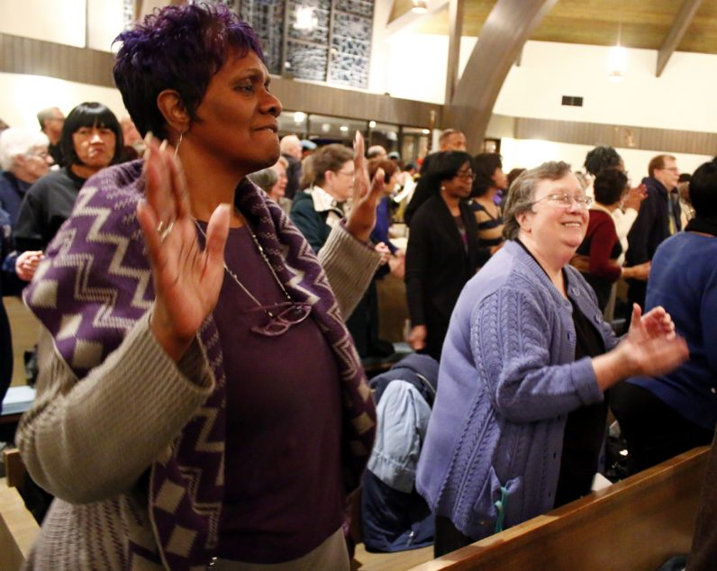 Carol Styles-Baylor, left, gives praise at the 34th annual Archdiocesan Gathering in honor of Rev. Dr. Martin Luther King Jr. on Monday, Jan. 16.