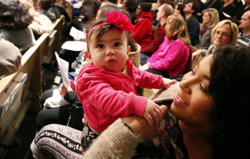Jasmine Small holds her little sister Jaylyn Boyle who might have been the youngest in attendance of the annual gathering.
