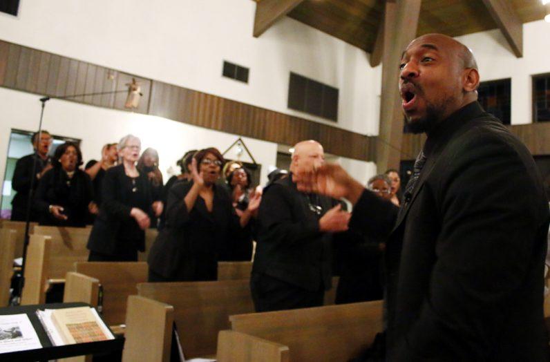 The Philadelphia Mass Choir fills the church with praise.