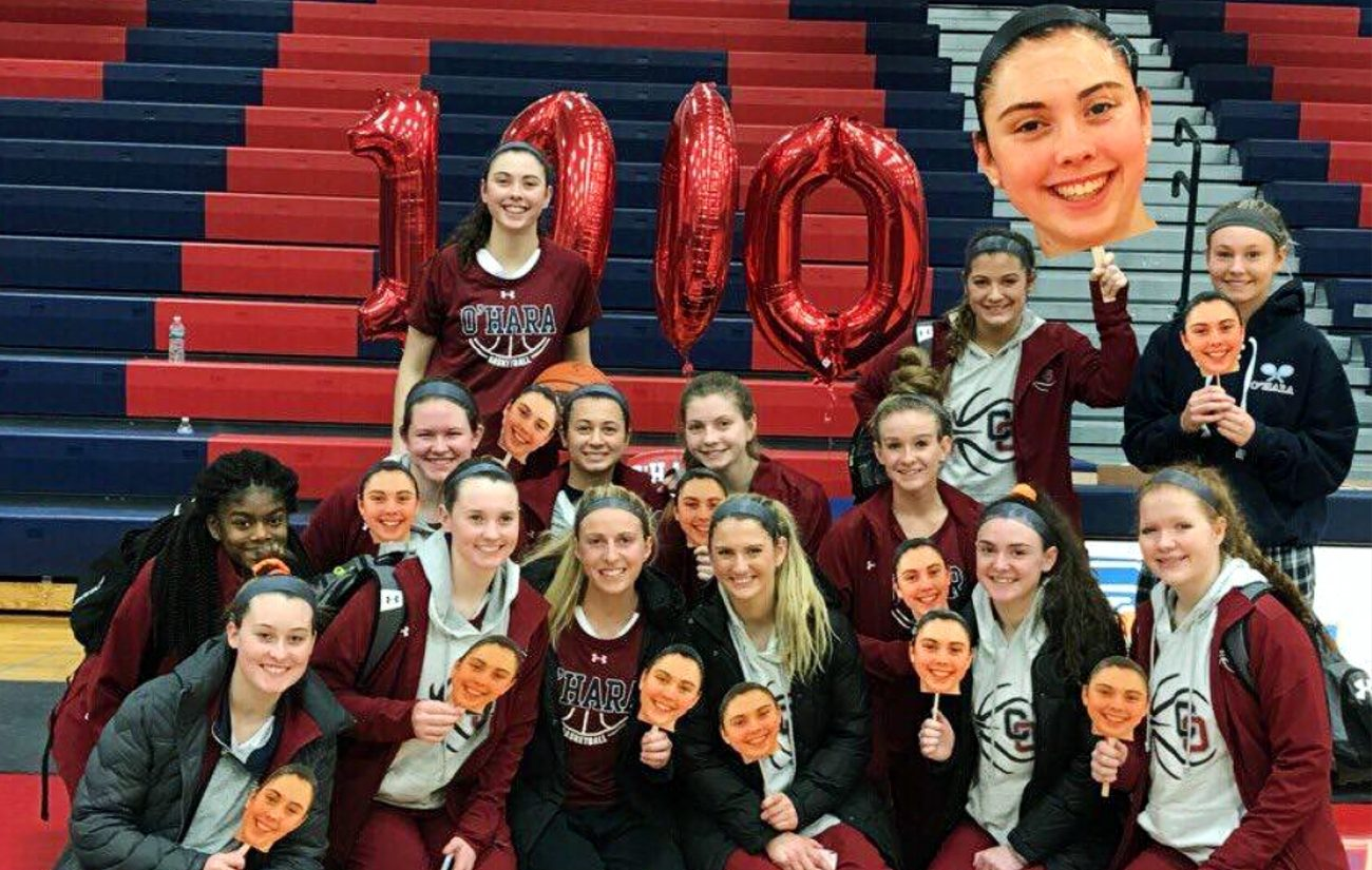 Mary Sheehan (top row far left), shows the support of her Cardinal OHara basketball teammates as she passed a major milestone,1,000 career points, on Jan. 5.