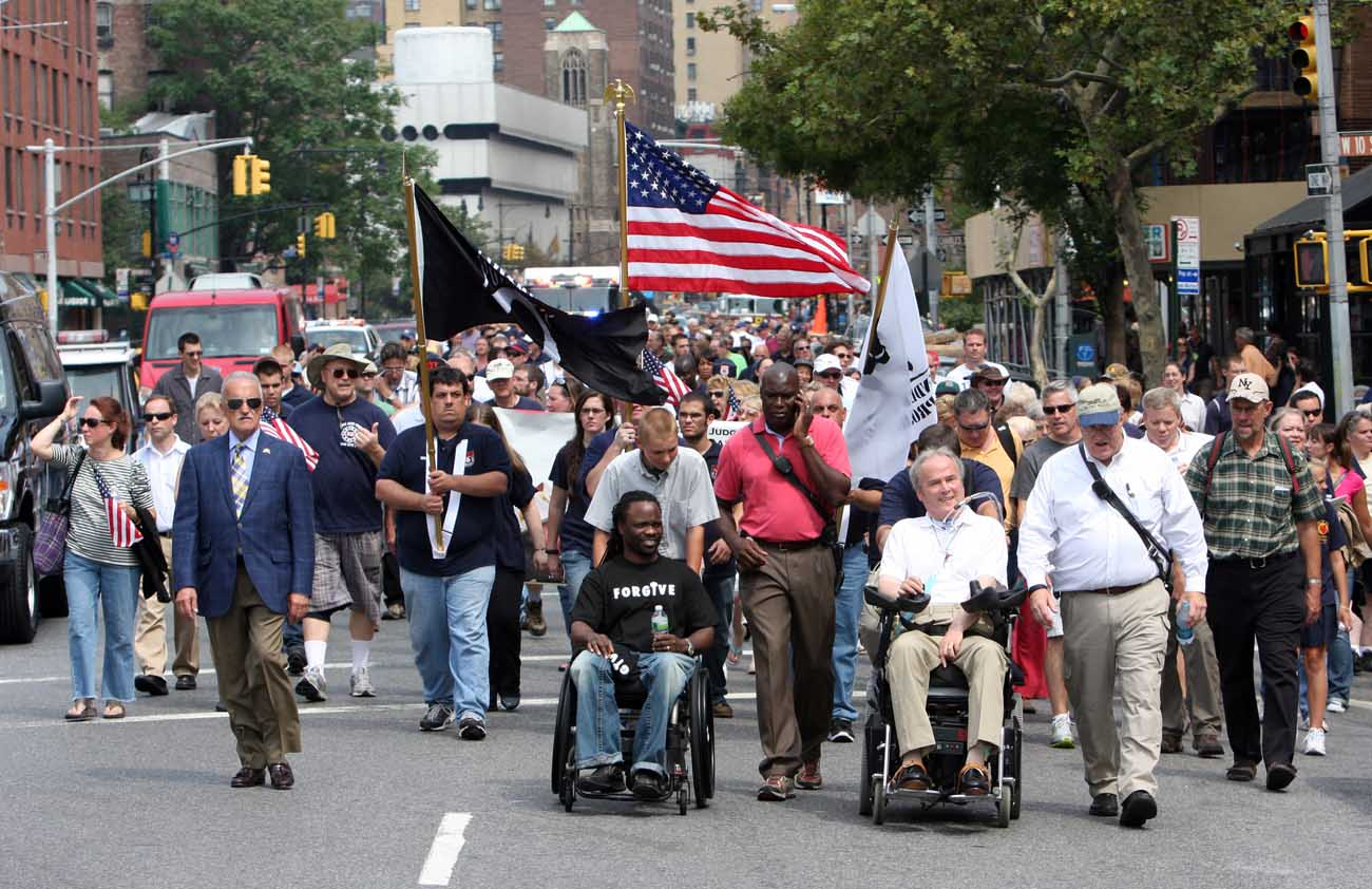 Detective Steven McDonald of the New York Police Department, in wheelchair at right, participates in the 10th annual Father Mychal F. Judge Walk of Remembrance in New York in Sept. 2011. McDonald, who founded the walk in 2002, died Jan. 10 at a Long Island hospital at age 59. (CNS photo/Gregory A. Shemitz)
