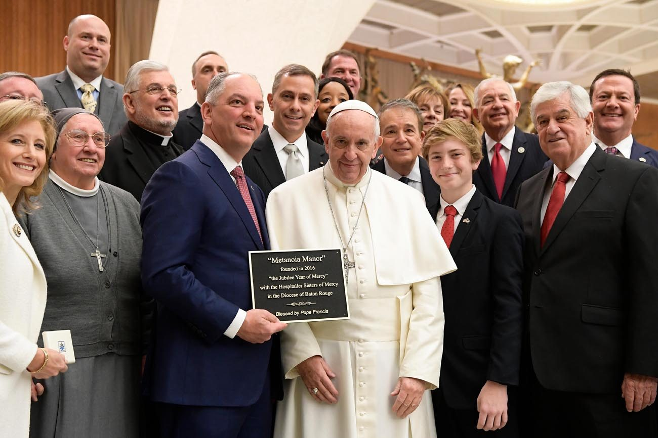 Pope Francis poses for a photo with Louisiana Gov. John Bel Edwards and his delegation during the pope's general audience at the Vatican Jan. 18. (CNS photo/L'Osservatore Romano, handout)