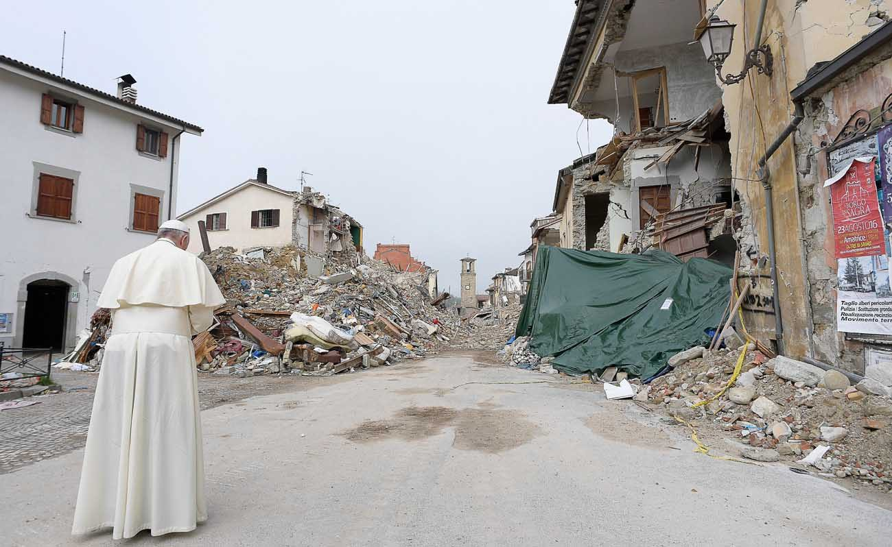 Pope Francis prays as he visits the earthquake-ravaged town of Amatrice, Italy, in August 2016. Pope Francis said along with rebuilding their lives, survivors of the earthquake also must rebuild their hearts with a strong foundation of hope. (CNS photo/L'Osservatore Romano)