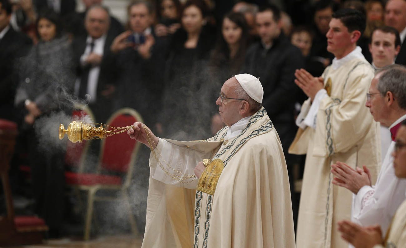 Pope Francis uses incense during vespers on New Year's Eve in St. Peter's Basilica at the Vatican Dec. 31. (CNS photo/Paul Haring)