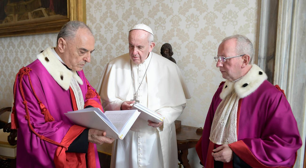 Pope Francis talks with Msgr. Pio Vito Pinto, dean of the Roman Rota, and Father Maurice Monier, pro-dean, during a meeting inaugurating the judicial year of the Roman Rota at the Vatican Jan. 21. The Roman Rota is the highest appellate court in the Catholic Church; it mainly handles marriage cases. (CNS photo L'Osservatore Romano, handout)