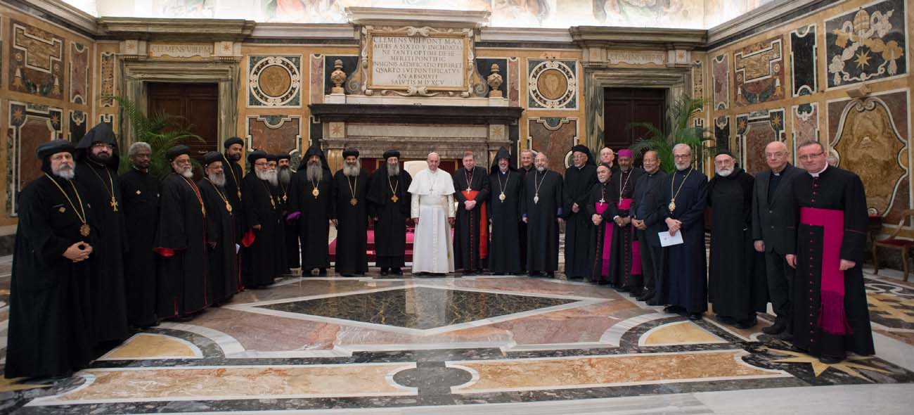 Pope Francis poses with attendees at a meeting with representatives of the Oriental Orthodox churches at the Vatican Jan. 27. The representatives were in Rome for a meeting of the Joint International Commission for Theological Dialogue between the Catholic Church and the Oriental Orthodox Churches. (CNS photo/L'Osservatore Romano, handout)