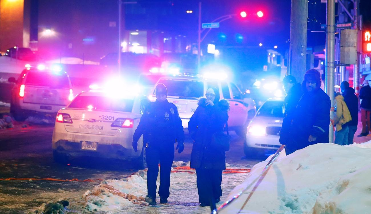Police officers are seen near a mosque after a shooting in Quebec Jan. 29. (CNS photo/Mathieu Belanger, Reuters)