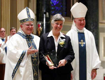 Archbishop Charles Chaput (left), Auxiliary Bishop Michael Fitzgerald (right) and Sister Kathleen Schipani, I.H.M., pose for a photo after Mass. (Sarah Webb)