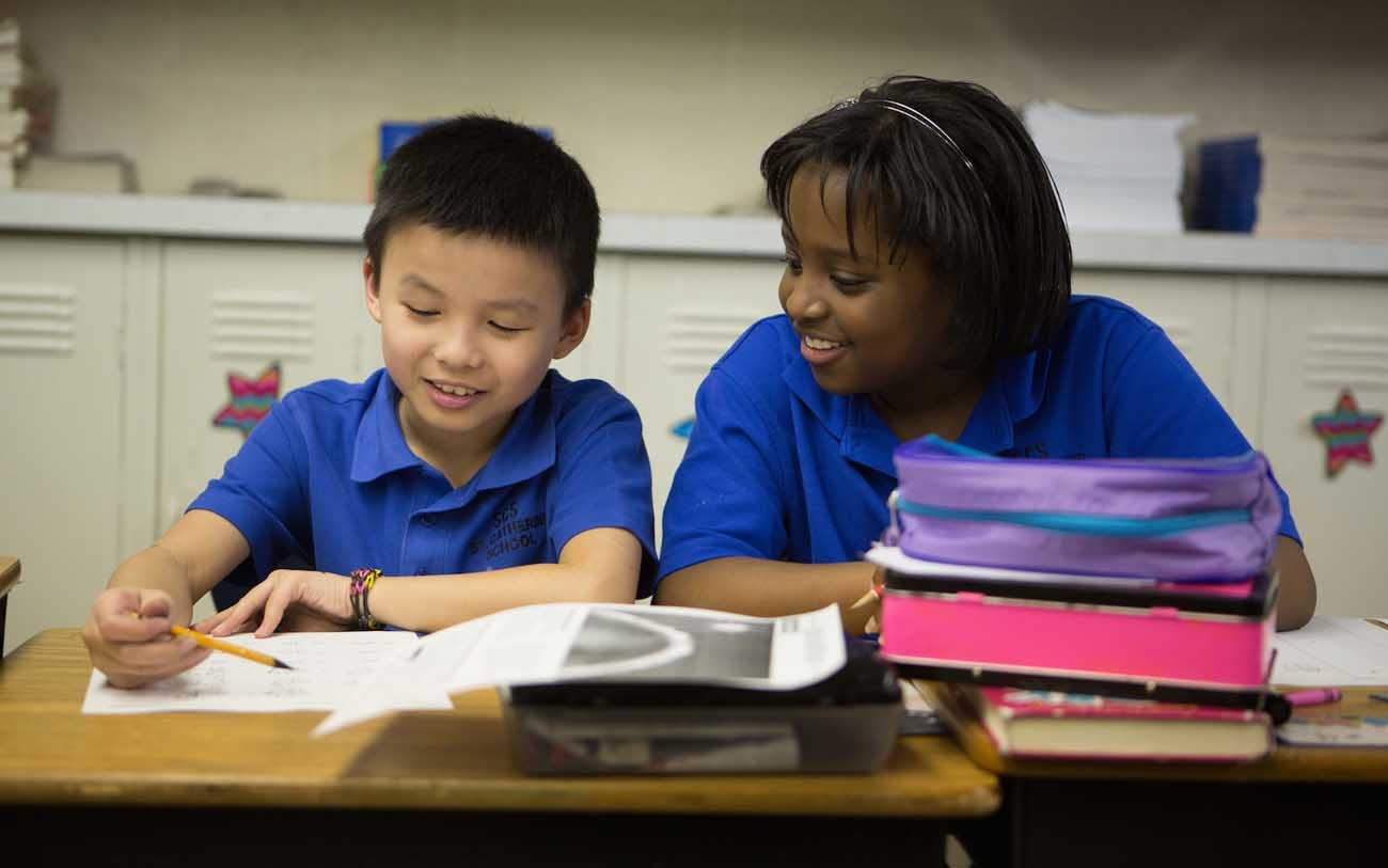 In this undated photo, students work together at St. Catherine of Siena School in the Diocese of Beaumont. The school's growing student population is diverse with 42 percent Latino, 25 percent Asian, 23 percent African-American and 10 percent Caucasian. (CNS photo/courtesy Catholic Extension)