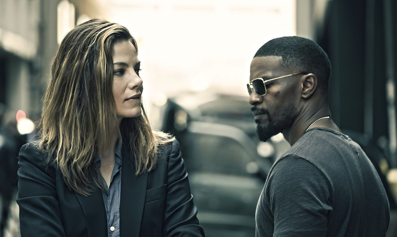 "Michelle Monaghan and Jamie Foxx star in a scene from the movie ""Sleepless.""  (CNS photo/Open Road Films)"