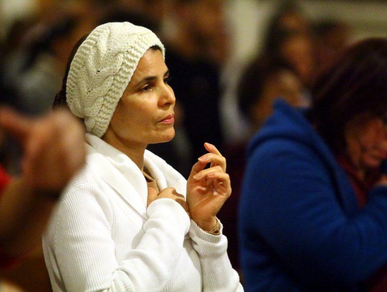 Juana Maria Comacho prays during Mass.