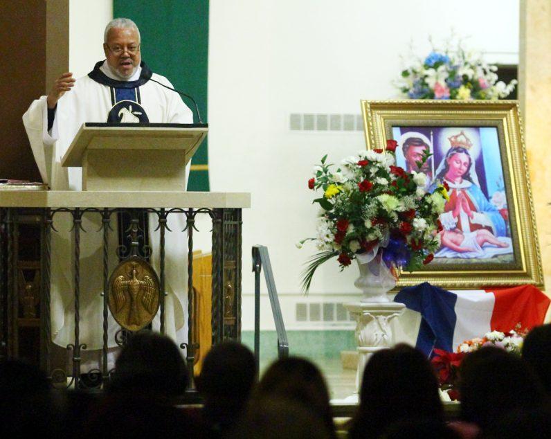 Fr. Rafael Vargas preaches during Mass.