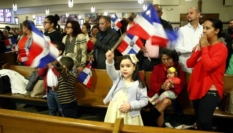 Neolia Valdez proudly waves her flag.