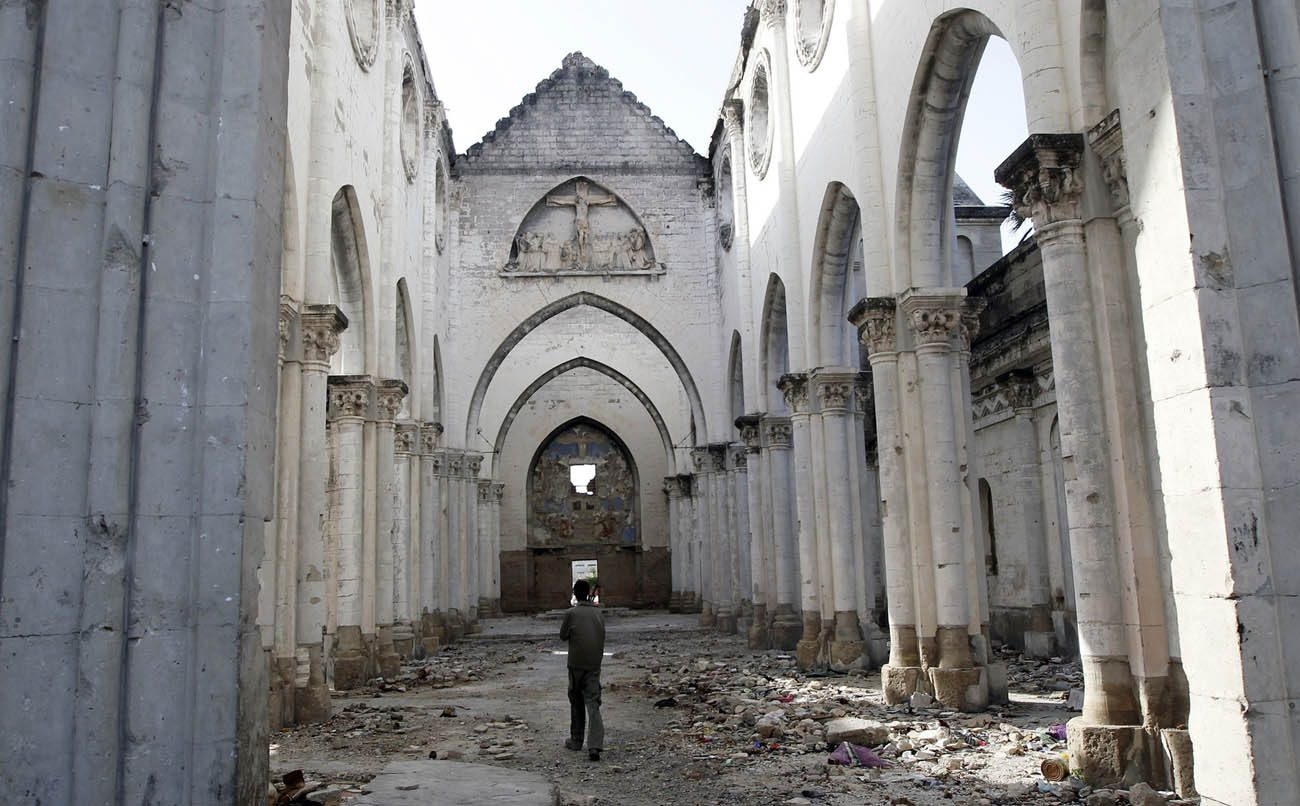A man is seen in 2012 walking through a Catholic church destroyed during the civil war in Mogadishu, Somalia. (CNS photo/Goran Tomasevic, Reuters)