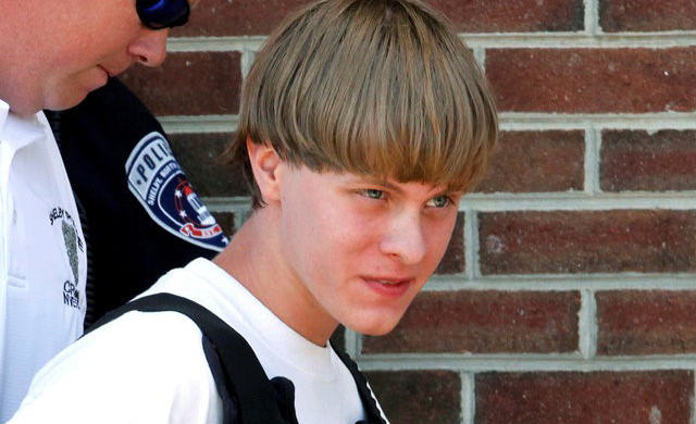 Police lead suspected shooter Dylann Roof into the courthouse in 2015 in Shelby, N.C. Jurors unanimously agreed to sentence Roof to death for killing nine black churchgoers in 2015 at Emanuel AME Church in Charleston, S.C. (CNS photo/Jason Miczek, Reuters)