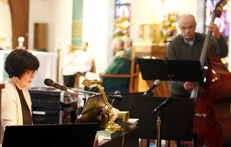 Elaine Johnson and Bob Gainer provide music for Mass at St. Robert Bellarmine Church.