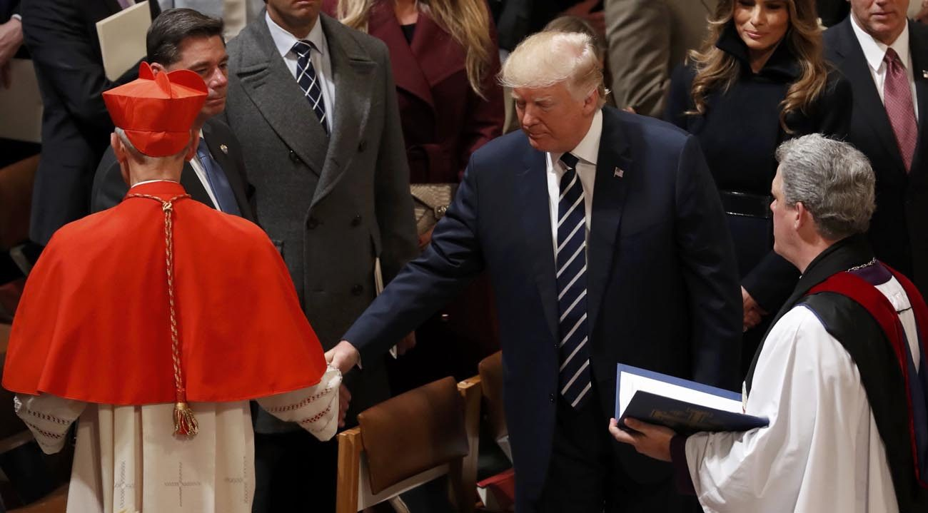 U.S. President Donald Trump greets Cardinal Donald W. Wuerl of Washington during an interfaith prayer service at the National Cathedral in Washington Jan. 21, the day after Trump's swearing-in as the country's 45th president. (CNS photo/Kevin Lamarque, Reuters)