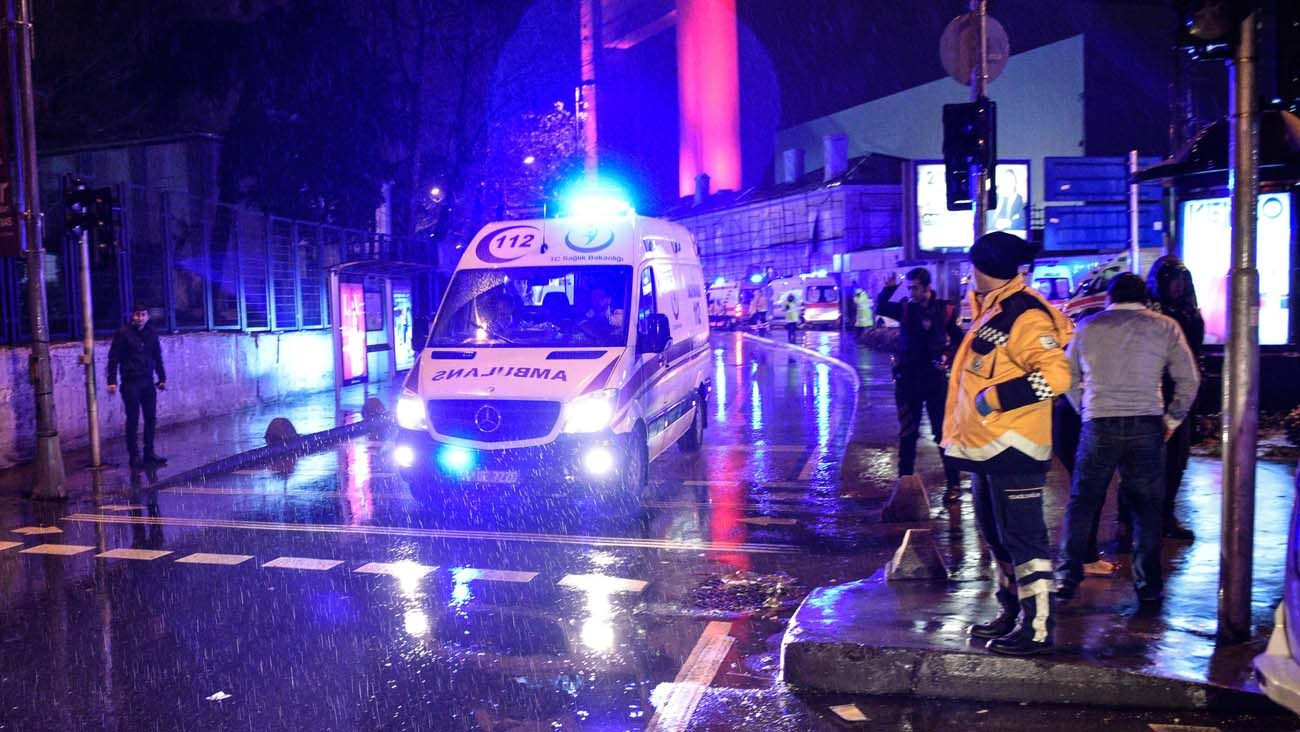 Ambulances transport people wounded during an attack on a New Year's Eve celebration at a popular nightclub in Istanbul. At least 39 people, mostly foreigners, were killed and dozens injured in the attack. (CNS photo/EPA)