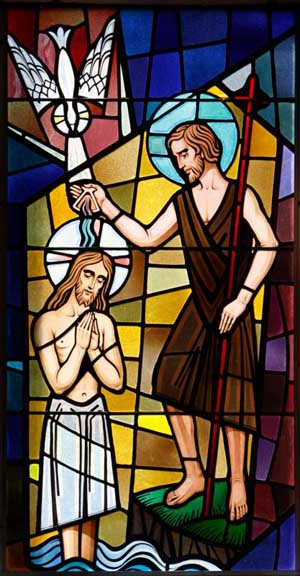 Christ's baptism at the Jordan River is depicted in a stained-glass window at St. Francis of Assisi Church in Greenlawn, N.Y. Throughout the Gospel stories, Jesus is shown taking time for prayer regularly. Following his baptism by John, Jesus went off by himself into the desert to fast and pray to prepare for the temptations he would experience. (CNS photo/Gregory A. Shemitz, Long Island Catholic)