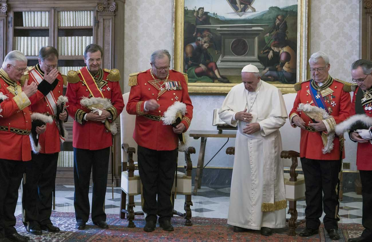 Pope Francis prays with Fra Matthew Festing, (fourth from left), grand master of the Sovereign Military Order of Malta, and Albrecht Freiherr von Boeselager (third from left), then-grand chancellor of the order, during a private audience with members of the order at the Vatican in this June 23, 2016, file photo. Pope Francis has established a commission to look into the dismissal of the order's grand chancellor, von Boeselager; Fra Festing said the commission members are unfit to address the situation objectively. (CNS photo/Maria Grazia Picciarella, pool)