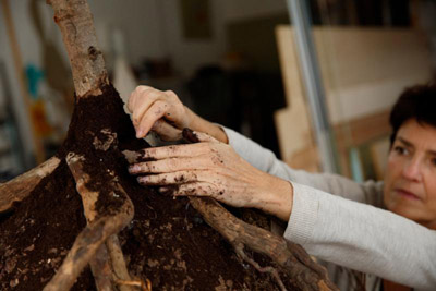 Anna Citelli places dirt on a sample biodegradable burial pod developed by her company, Capsula Mundi, at its design studio in Rome Oct. 11. (CNS photo/Paul Haring)