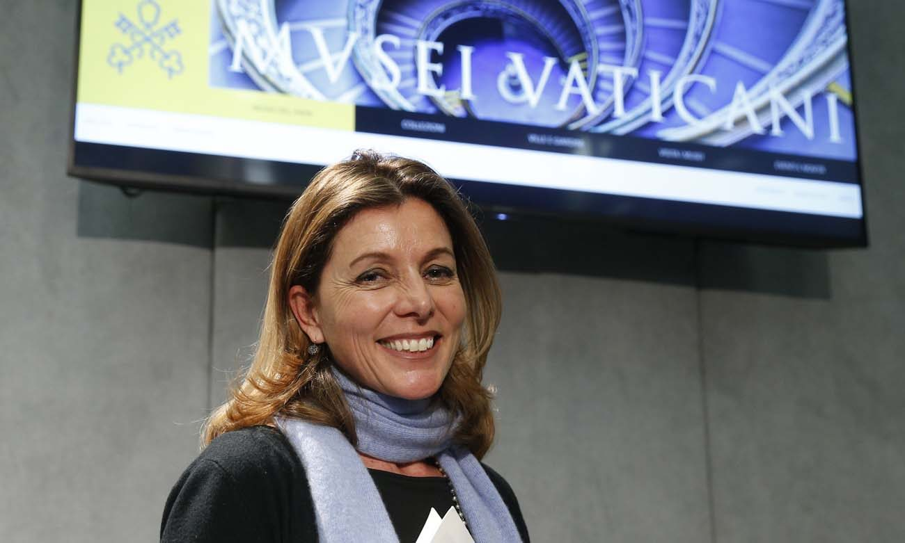Barbara Jatta, the new director of the Vatican Museums, leaves a Jan. 23 Vatican news conference at which the revamped, mobile-compatible website for the Vatican Museums was unveiled. (CNS photo/Paul Haring)