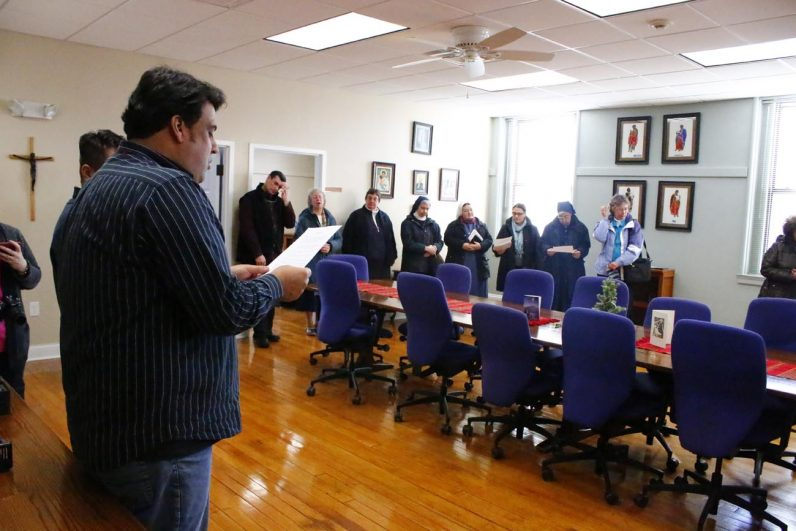 Participants of the executive committee representing 200 congregations of the 1 million-member Vincentian global family pray before one of their Jan. 6-7 planning meetings. (Sarah Webb)
