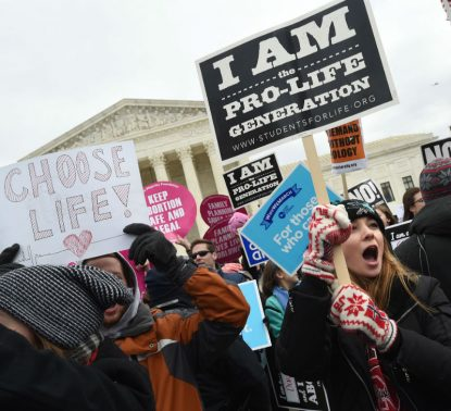 Pro-life advocates gather outside the U.S. Supreme Court Jan. 27 during the annual March for Life in Washington. (CNS photo/Leslie E. Kossoff)