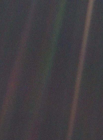 "This narrow-angle color image of the Earth, dubbed ""Pale Blue Dot,"" is a part of the first ever ""portrait"" of the solar system taken by Voyager 1. The spacecraft acquired a total of 60 frames for a mosaic of the solar system from a distance of more than 4 billion miles from Earth and about 32 degrees above the ecliptic. From Voyager's great distance Earth is a mere point of light, less than the size of a picture element even in the narrow-angle camera. Earth was a crescent only 0.12 pixel in size. Coincidentally, Earth lies right in the center of one of the scattered light rays resulting from taking the image so close to the sun. (NASA/JPL, Sept. 12, 1996)"