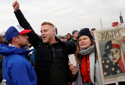 A supporter of U.S. President-elect Donald Trump confronts a demonstrator on the National Mall during Trump's swearing-in as the country's 45th president at the U.S. Capitol in Washington. (CNS photo/Shannon Stapleton, Reuters)