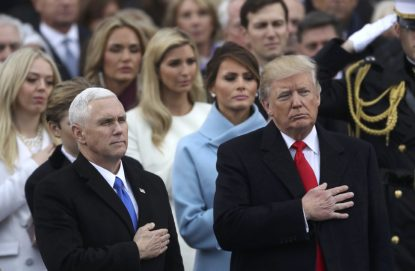 U.S Vice President Mike Pence and President Donald Trump stand for the singing of the national anthem after Trump's swearing-in as the country's 45th president at the U.S. Capitol in Washington. (CNS photo/Carlos Barria, Reuters)