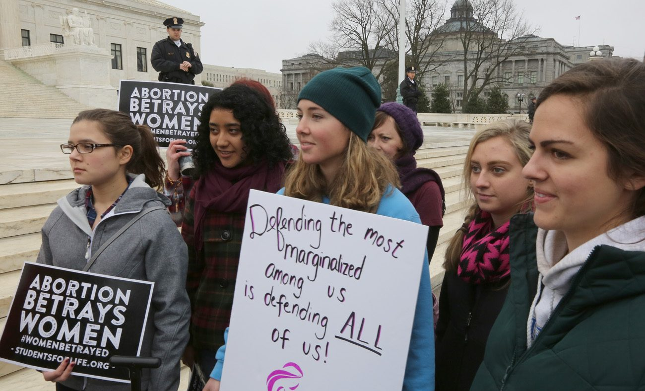 Mary Solitario, 21, center, a Catholic from Virginia, joins a pro-life demonstration outside the U.S. Supreme Court prior to the Women's March on Washington Jan. 21. (CNS photo/Bob Roller)