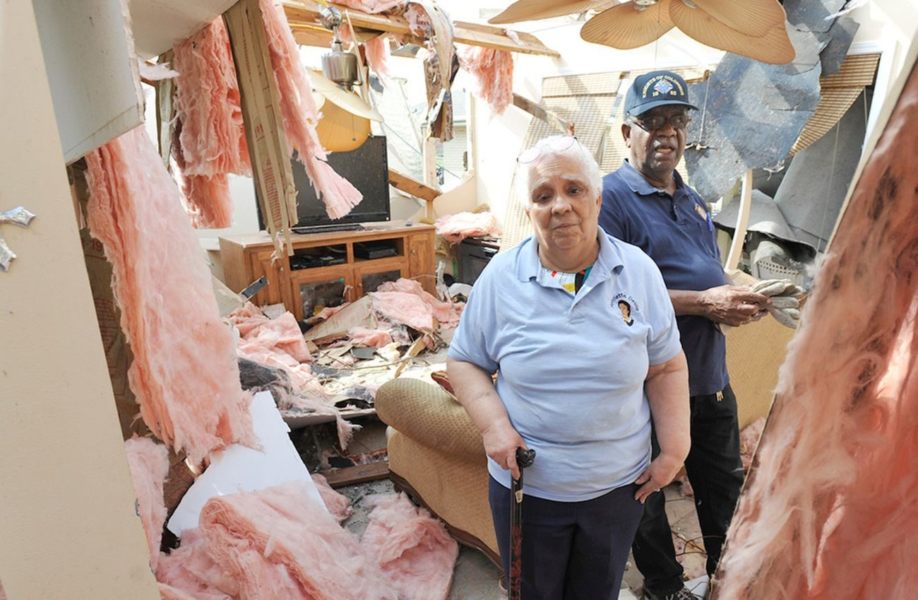 Vergie and Roger Davis, parishioners of Resurrection of Our Lord Parish in New Orleans East, assess the damage to their home, which was destroyed by a tornado Feb. 7. Their home is about five blocks from the church. The Davises have endured a house fire in 1982 and flooding from Hurricane Katrina in 2005 but say their faith is intact. (CNS photo/Peter Finney Jr., Clarion Herald)