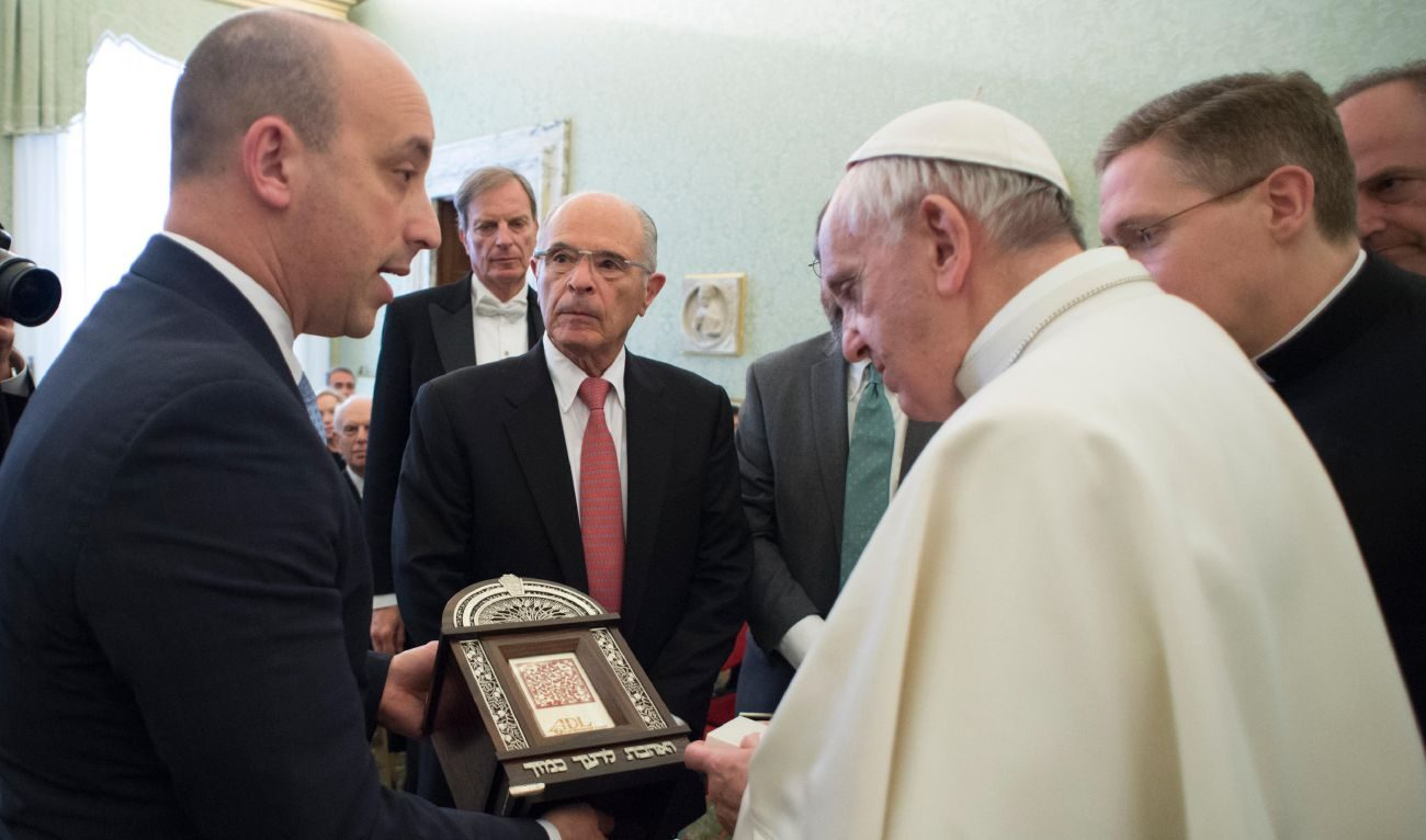 Pope Francis accepts a gift from Jonathan Greenblatt, CEO and national director of the Anti-Defamation League, during a meeting with a delegation from the organization at the Vatican Feb. 9. The pope denounced anti-Semitism and reaffirmed that the Catholic Church has a duty to repel such hatred. (CNS photo/L'Osservatore Romano, handout)