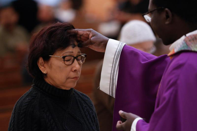 Ashes are distributed at St. Helen Church in Glendale, Ariz., in this 2016 file photo. On Ash Wednesday, we sign ourselves as disciples of Jesus Christ, and we strive to live the following 40 days so that the world knows we are Christians. (CNS photo/Nancy Wiechec)