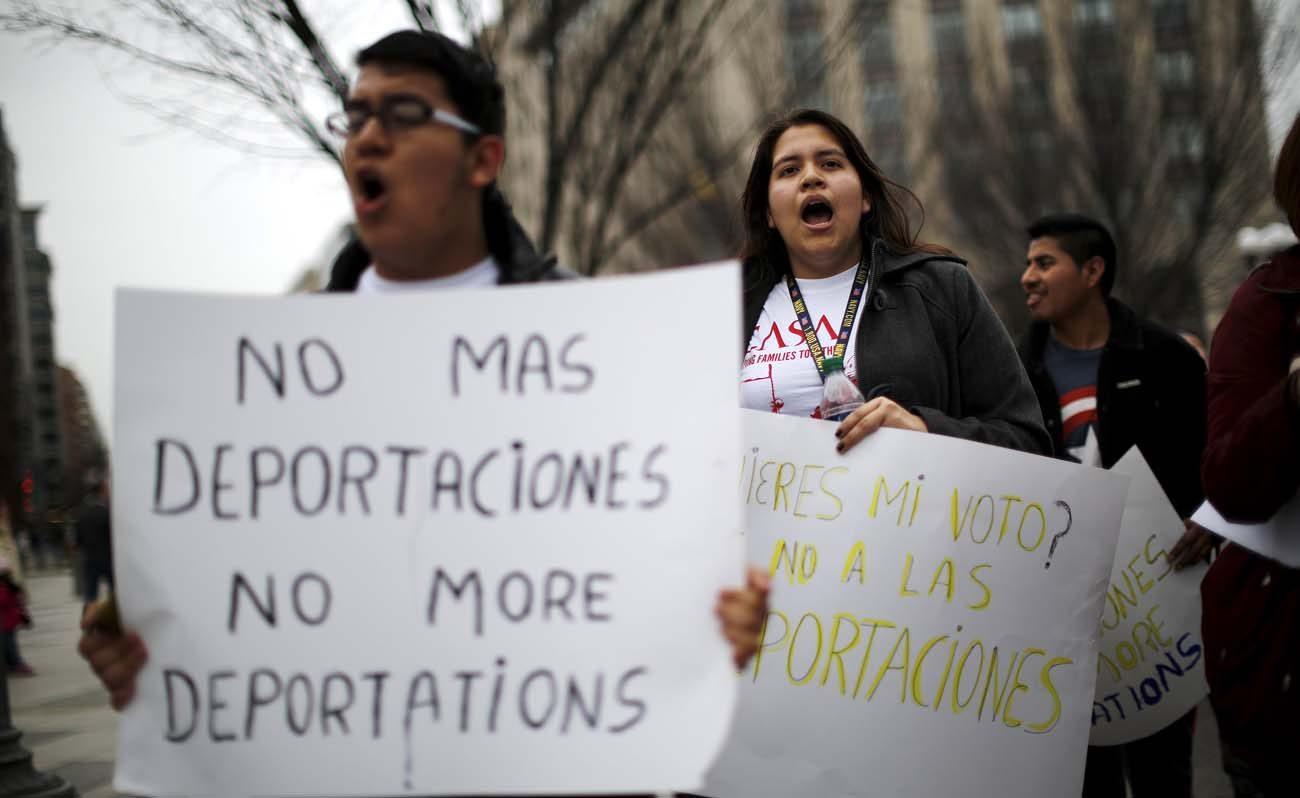 Demonstrators call for an end to deportations in a protest outside the White House in Washington in this late December, 2015, file photo. (CNS photo/Carlos Barria, Reuters)