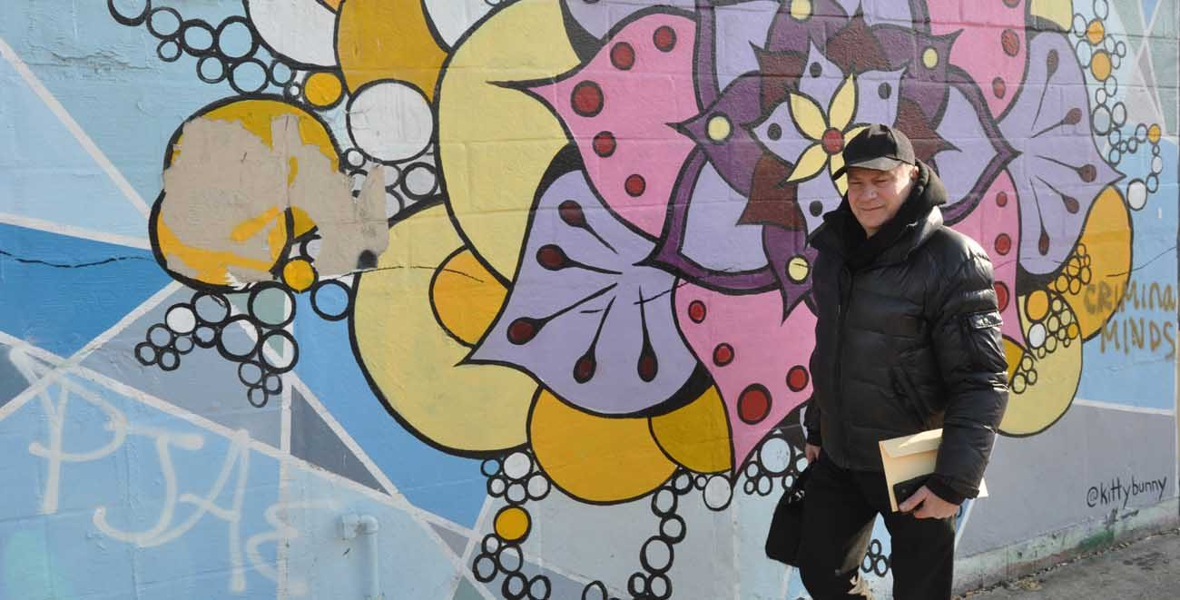 Father Frank Mann views some of the street art Feb. 8 in the Bushwick section of Brooklyn, N.Y. Father Mann, a priest in the Brooklyn Diocese, begun a ministry to the young artists who have  been drawn to the neighborhood. (CNS photo/Ed Wilkinson, The Tablet)