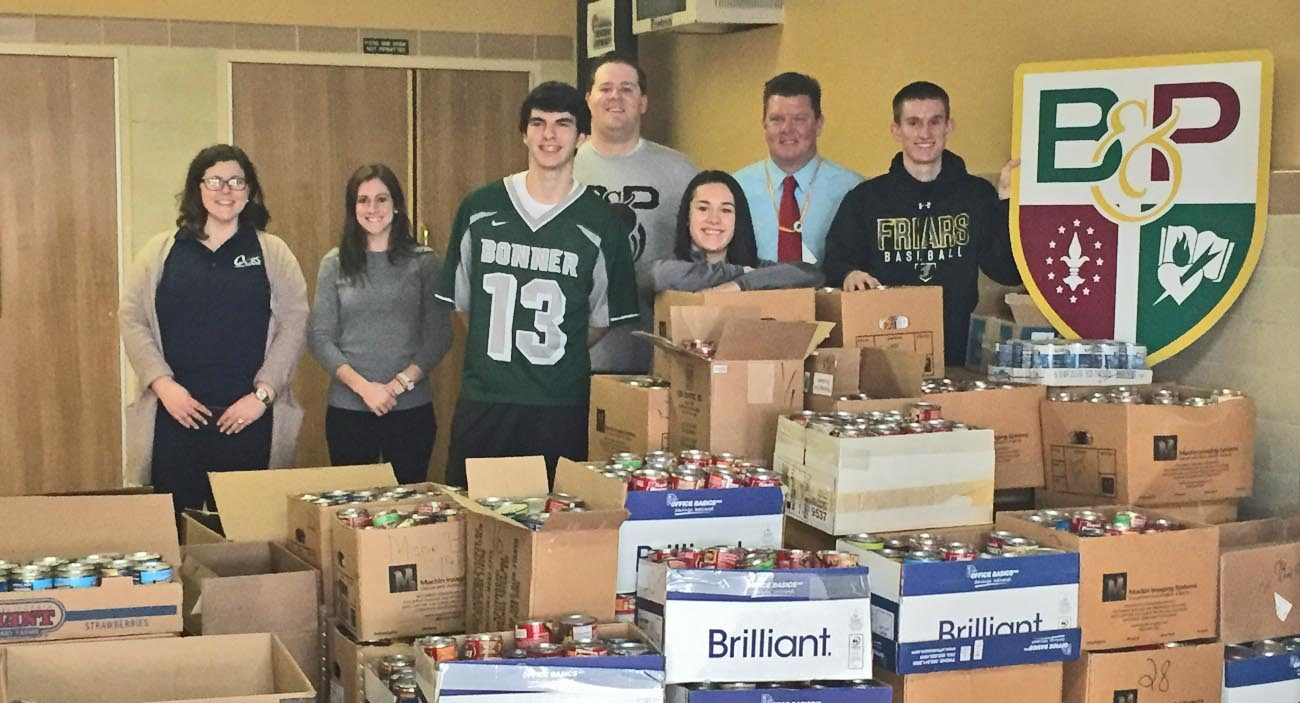 "Students and faculty of Msgr. Bonner and Archbishop Prendergast High School show the 2,017 pounds of food they collected in the ""Souper Bowl of Caring"" donation drive benefiting 30 Philadelphia-area food cupboards."