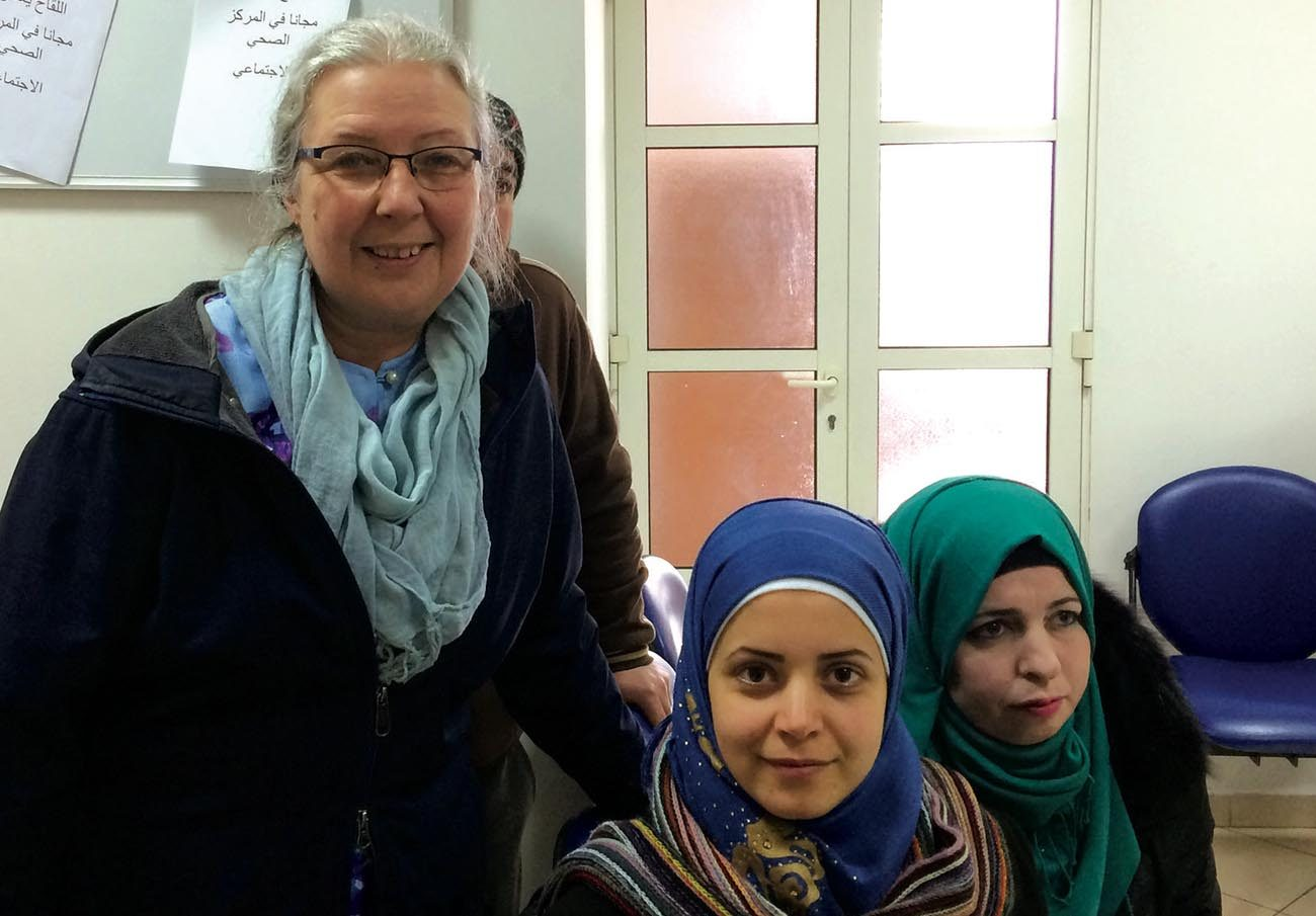 Helene Tremblay-Boyko, vice president of the Development and Peace national council, poses with two Syrian refugees, Ghada and Iblissam, Feb. 1 at the Caritas Lebanon Medical Center in Rayfoun.  (CNS photo/courtesy Development and Peace)