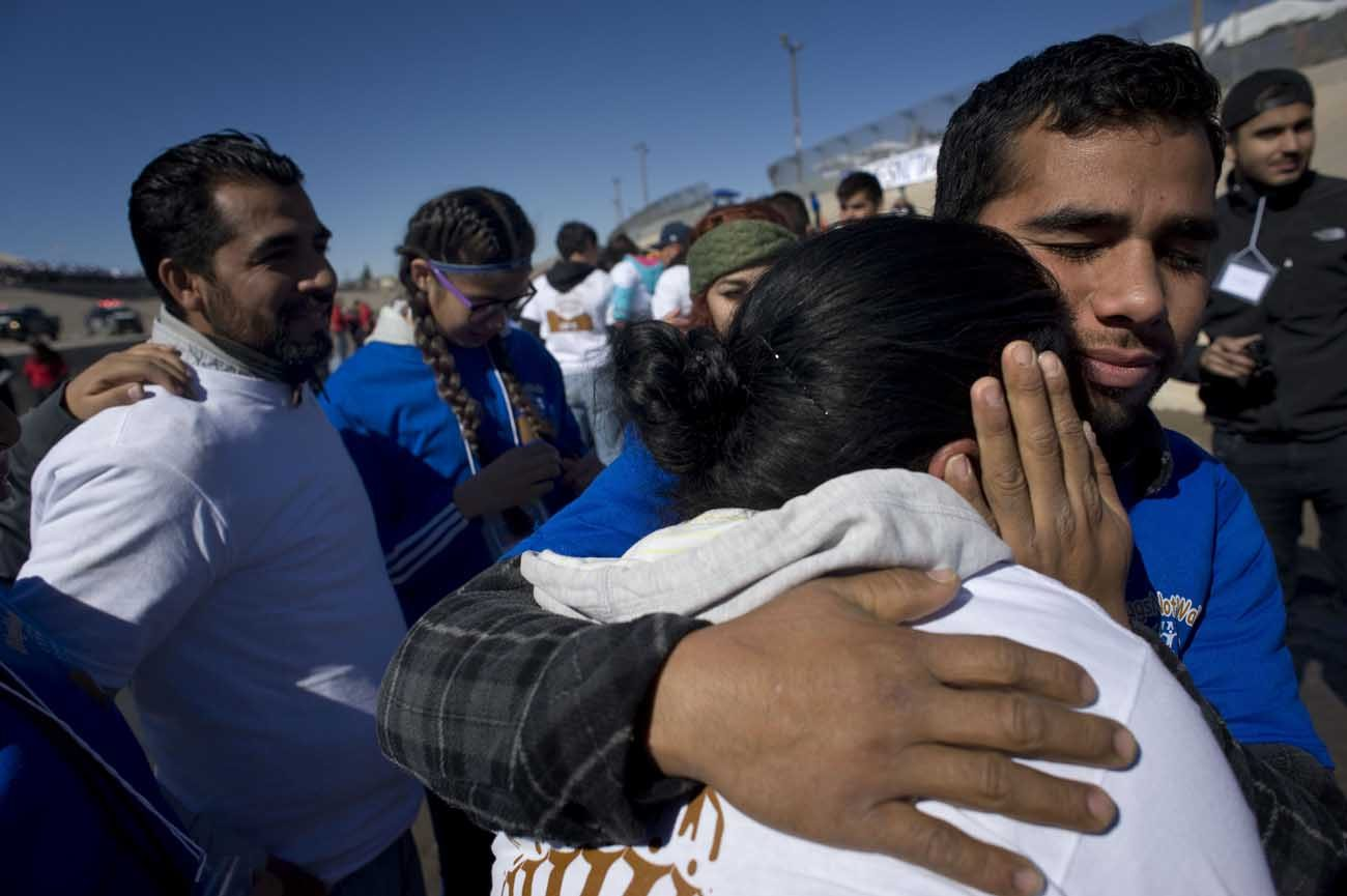 """Family members embrace during a massive reunion called """"Abrazos, No Muros"""" (Hugs, Not Walls) Jan. 28. Canadian refugee advocates expect to see a slight increase in border crossings from the U.S. as it toughens its immigration enforcement. (CNS photo/David Maung)"""