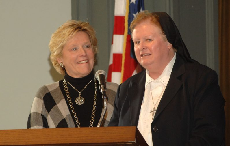 Catholic Relief Services Eastern Regional Director Maureen McCullough, left and Immaculate Heart Sister Maureen McDermott, superintendent of secondary Schools for the archdiocese, speak at the Helping Hands event.