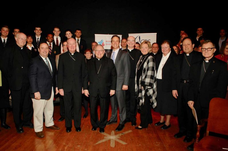 Archbishop Charles Chaput, center, poses with the leaders of Catholic schools and  Catholic Relief Services.
