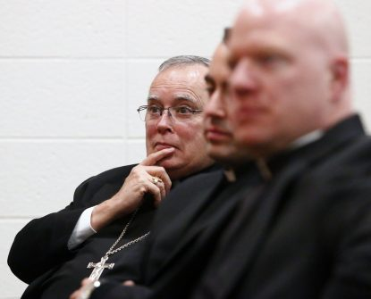Archbishop Charles Chaput and priests in attendance listen intently during the Cardinal John Foley lecture Jan. 30 at St. Charles Borromeo Seminary, Wynnewood. (Sarah Webb)