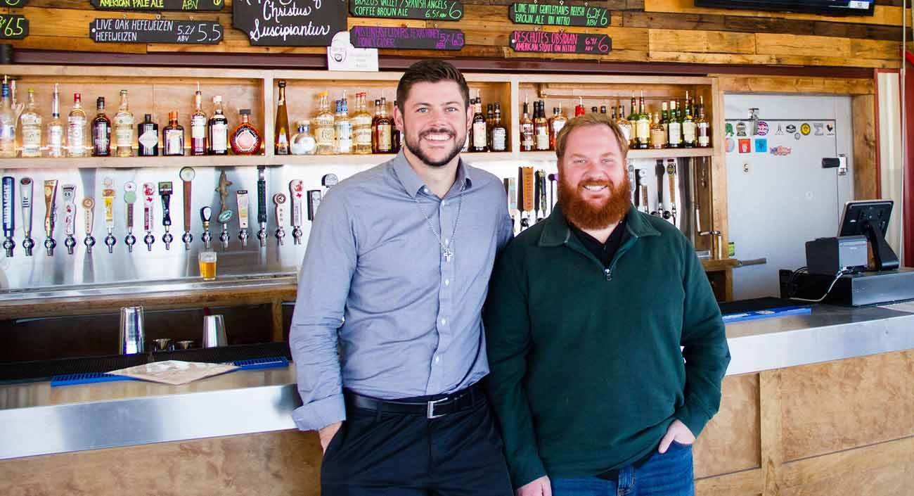 Co-owners Kevin Mims and Joey Muckenthaler, who opened Deacon Baldy's Food Truck Park in Houston in 2016, pose for a photo Jan. 31. The food truck park was named after Mims' late father, Deacon Mike Mims of St. Anthony of Padua Catholic Church in suburban Houston. (CNS photo/James Ramos, Texas Catholic Herald)