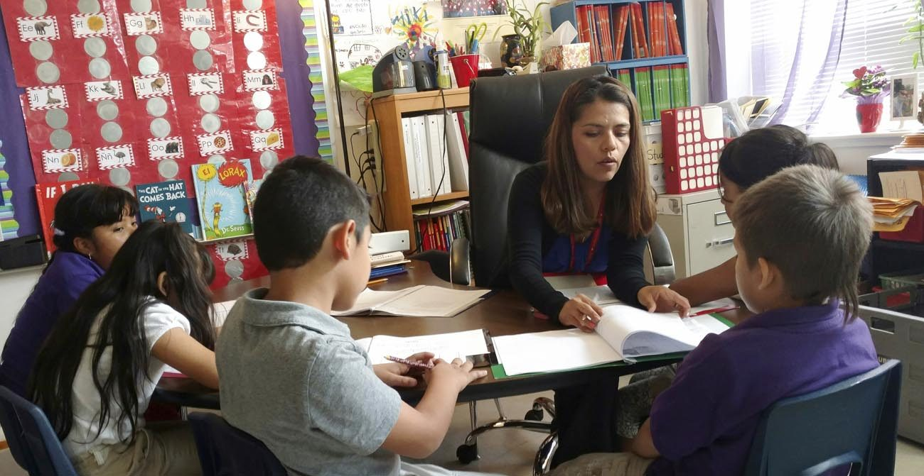 Teacher Maria Dominguez works with students at Rodriguez Elementary School in Austin, Texas. She was among the first to receive DACA (Deferred Action for Childhood Arrivals) status. Dominguez said that among her students and their parents, over the Trump administration's immigration proposals. (CNS photo/courtesy Maria Dominguez)