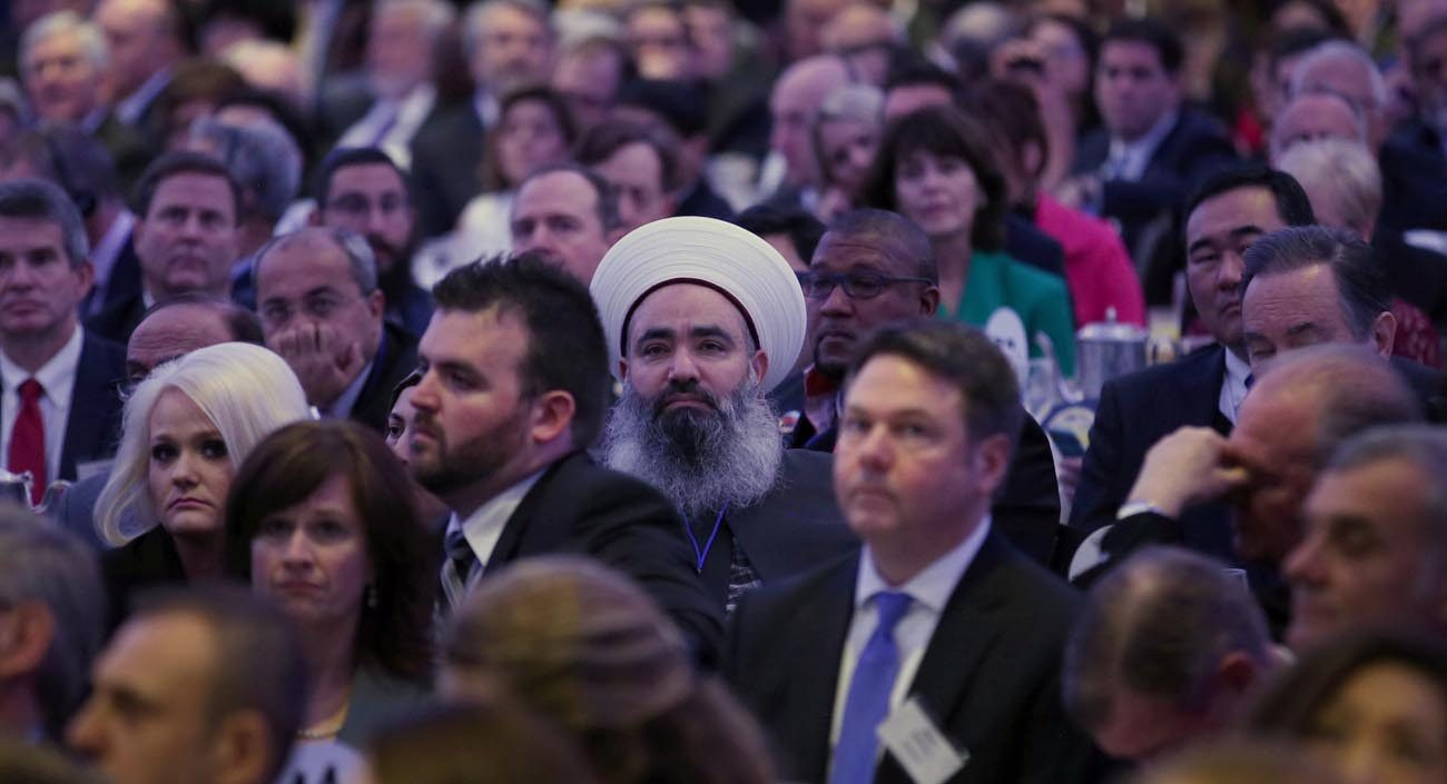 """Guests listen as U.S. President Donald Trump speaks during the National Prayer Breakfast Feb. 2 in Washington. Trump told guests he wants to """"get rid of and totally destroy"""" the Johnson Amendment. A bill to repeal it the Free Speech Fairness Act has just been introduced in the U.S. House. (CNS photo/Carlos Barria, Reuters)"""