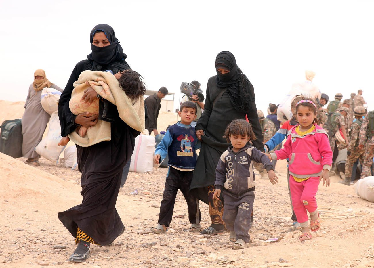 Syrian refugees arrive at a camp in 2016 in Royashed, Jordan. Promised resettlement in the United States, many Syrian refugees are frustrated over President Donald Trump's executive action banning their entry to the U.S. until further notice. (CNS photo/Jamal Nasrallah, EPA)