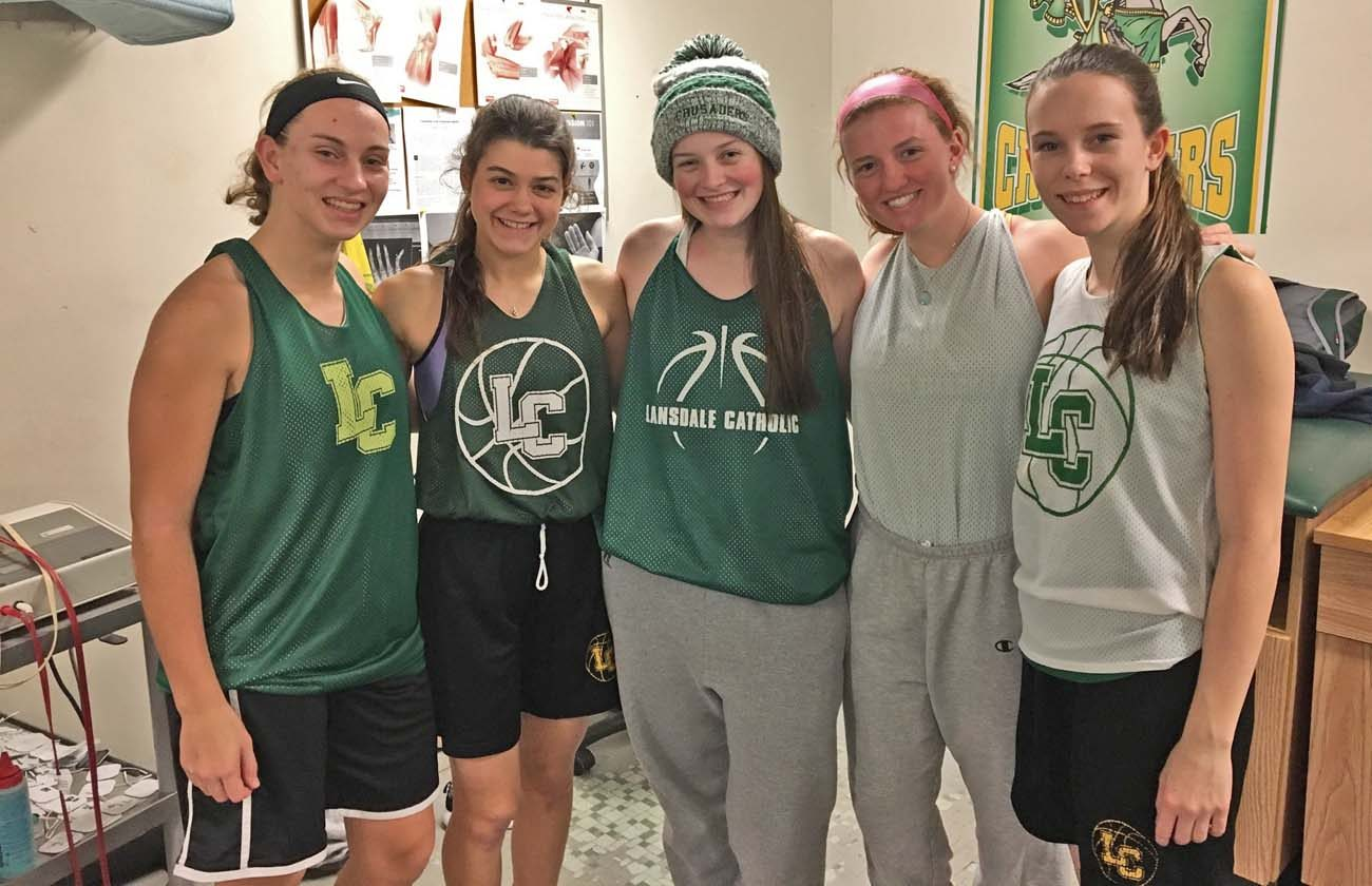 Key players on the Lansdale Catholic girls' basketball team include, from left, Laura Vetter, Megan Maloney, Holly Schneider, Lindsay Rock, and Miranda Grant.