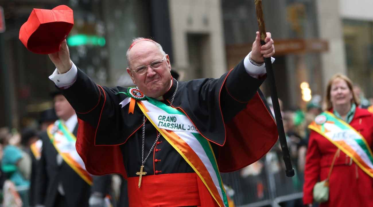 New York Cardinal Timothy M. Dolan waves to the crowd while serving as grand marshal of the St. Patrick's Day Parade in New York City in 2015. When St. Patrick's Day falls on a Friday, as it does this year and about every seven years, the Lenten rule requiring Catholics to abstain from meat on Fridays collides with the long-held holiday tradition of eating corned beef and cabbage. (CNS photo/Gregory A. Shemitz)