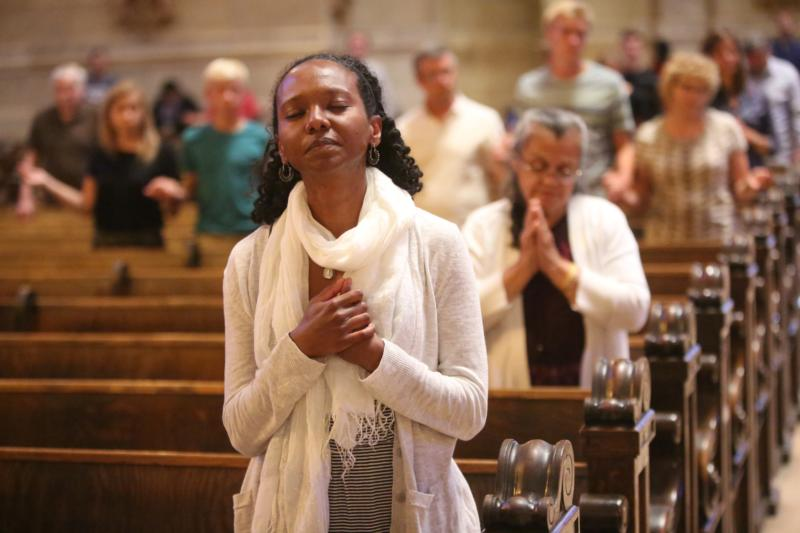 "A woman prays at the Cathedral of St. Paul in Minnesota July 8, 2016. During Lent, Catholics are challenged to embrace the season's three ""pillars"" -- prayer, fasting and almsgiving. (CNS photo/Dave Hrbacek, The Catholic Spirit)"